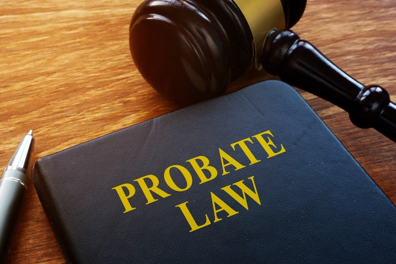 A book titled probate law lying on a desk with a gravel