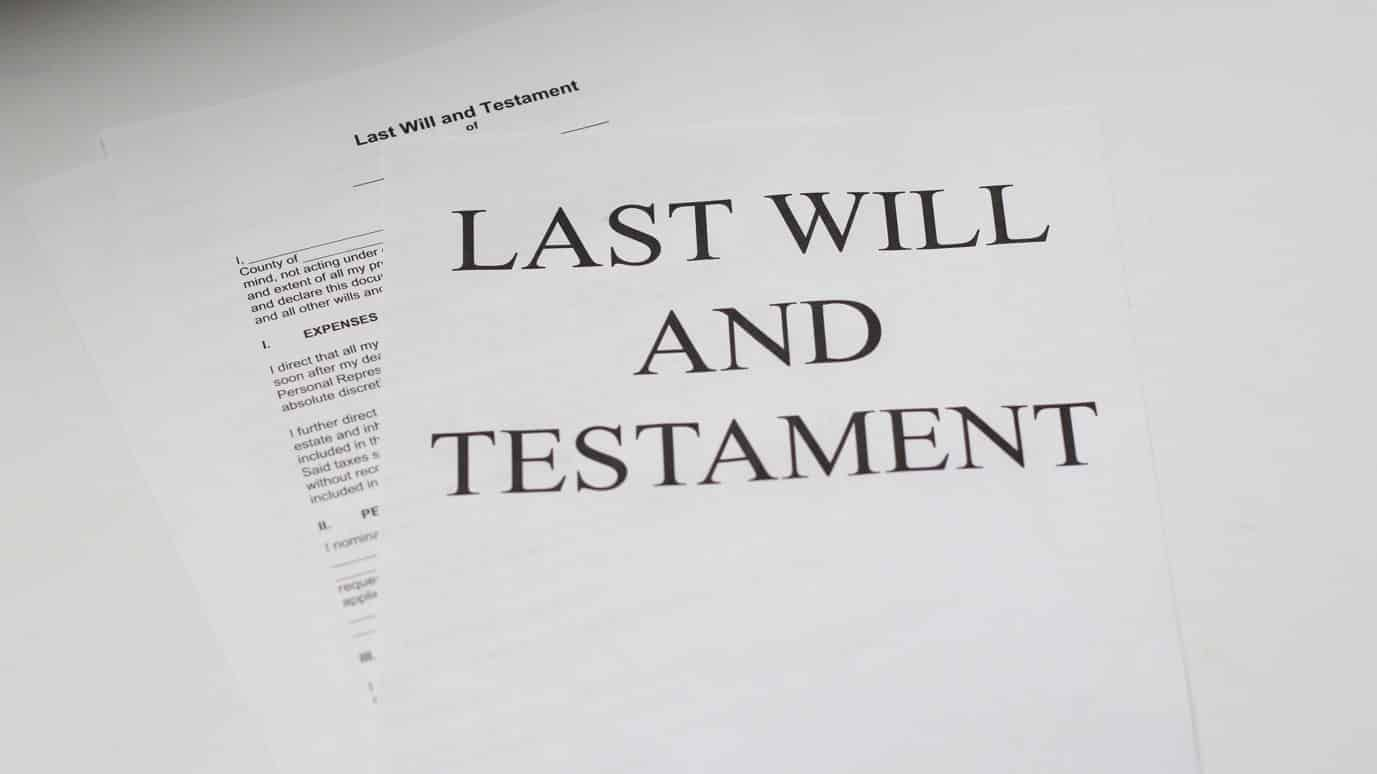 """A pile of papers labeled """"Last Will and Testament."""""""
