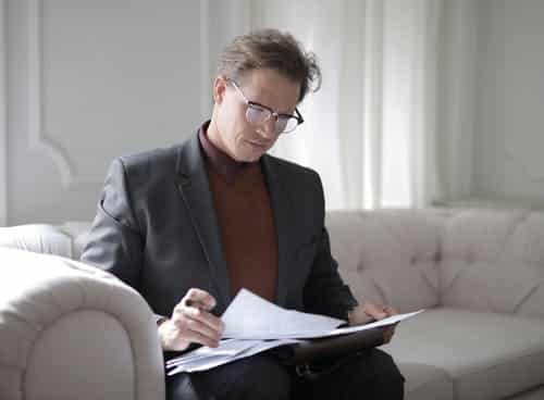 An estate lawyer studying documents