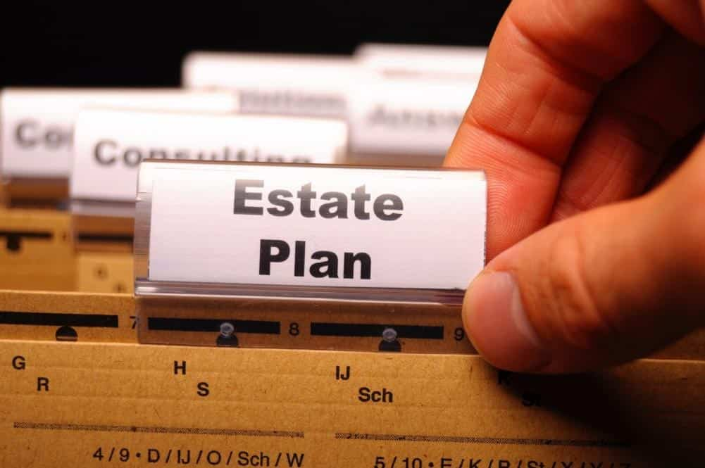Man picking out an estate plan file