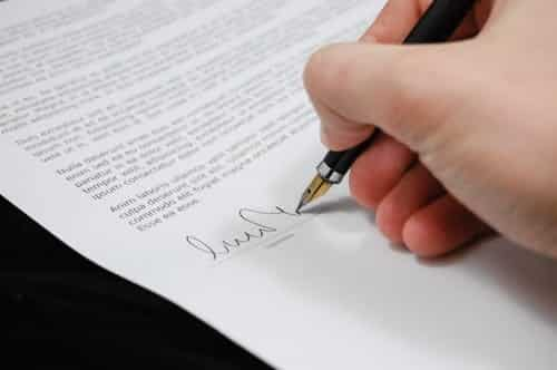 An estate attorney signing documents